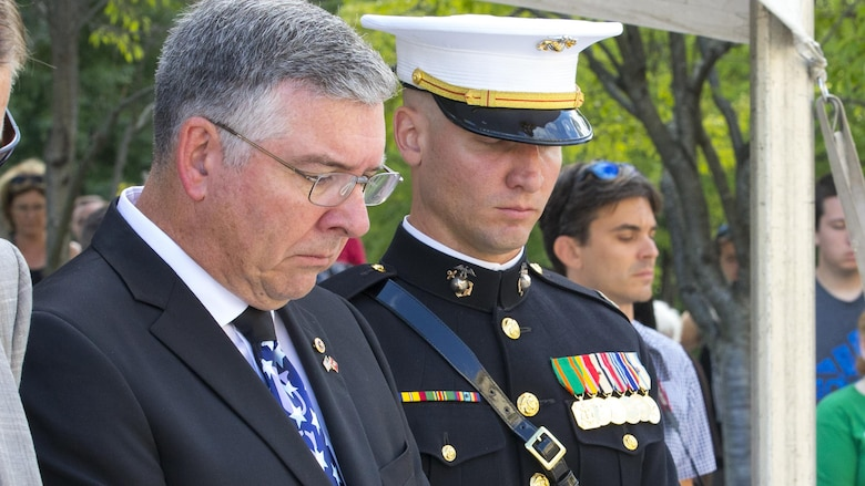 Capt. Eric M. Montgomery, right, and his father, left, bow their heads during the 9/11 Remembrance Ceremony, Nashville, Tenn., Sept. 11, 2016. Marine Week Nashville is a chance to reconnect with our Marines, sailors, veterans and their families from different generations.