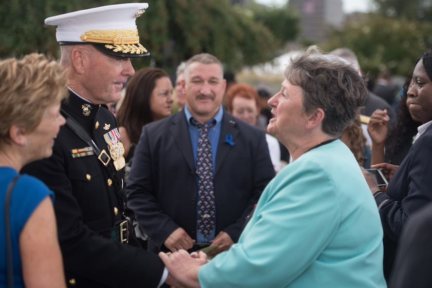 Marine Corps Gen. Joe Dunford, chairman of the Joint Chiefs of Staff, talks with an attendee during a remembrance ceremony.