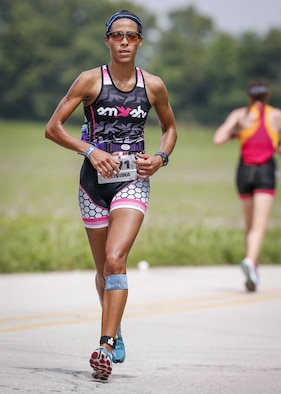 Maj. Christina Hopper runs during the Ironman 70.3 Muncie at Muncie, Indiana, July 11. Hopper completed her 13.1-mile run in 1:46:40. (Courtesy photo / finisherpix)