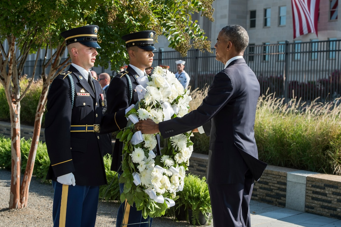 President Barack Obama places a wreath during a ceremony at the Pentagon marking the 15th anniversary of the 9/11 attacks, Sept. 11, 2016. DoD photo by Air Force Tech. Sgt. Brigitte N. Brantley