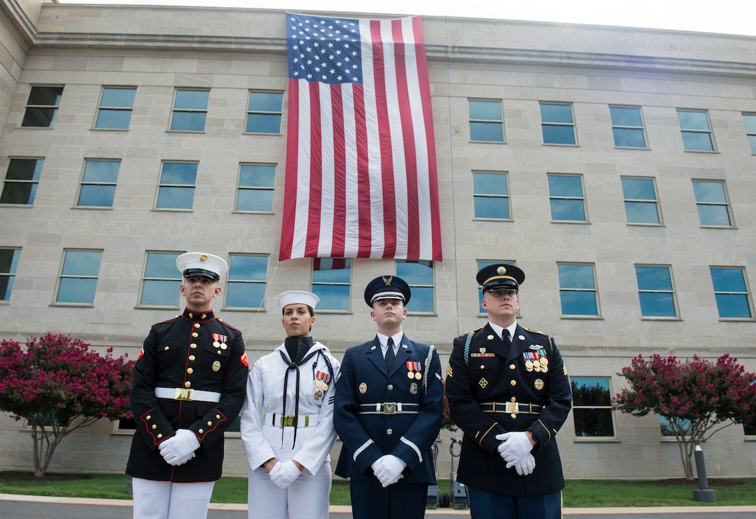 Service members stand after a ceremony at the Pentagon marking the 15th anniversary of the 9/11 attacks, Sept. 11, 2016. DoD photo by Air Force Tech. Sgt. Brigitte N. Brantley
