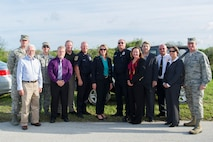 The Secretary of the Air Force Deborah Lee James, poses Sept. 9, 2016, with members of the 45th Space Wing Incident Management Team, who responded to the Falcon 9 Static Test Fire anomaly on Space Launch Complex 40 at Cape Canaveral Air Force Station, Fla. James met with the team and personally thanked them for managing the response to the anomaly. (U.S. Air Force photo/Matthew Jurgens)