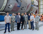 The Secretary of the Air Force Deborah Lee James, poses in front of a Falcon 9 booster with members of the 45th Space Wing and SpaceX during a tour to Kennedy Space Center's Space Launch Complex 39A Sept. 9, 2016, at Cape Canaveral, Fla.  Her two-day stay included an all call, meeting with members of Patrick-Cape and its mission partners, and a visit to the Atlas Spacecraft Operations Center where she witnessed her first launch at the Eastern Range. (U.S. Air Force photo/Matthew Jurgens)