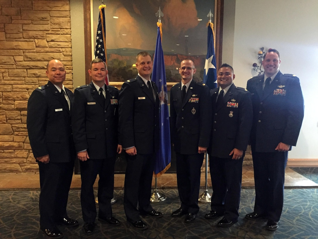 The School for Advanced Nuclear Deterrence Studies graduates its first six students, all active-duty Airmen from various career fields in Air Force Global Strike Command. The ceremony took place Sept.9, 2016, at Kirtland Air Force Base, New Mexico. From left to right: Maj. Allen Agnes, Maj. Jeffery Blackrick, Maj. Matthew Boone, Maj. Robert Evans, Maj. Marc Anthony Ortiz and Maj. David Pabst. (courtesy photo)