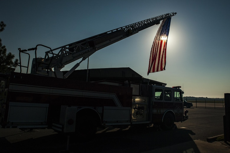 A U.S. flag hangs from a fire truck's ladder during a 9/11 memorial ceremony, Sept. 11, 2016, at Moody Air Force Base, Ga. On the 15th anniversary of the attacks, people gathered at Moody's fire department at 9:11 a.m. to pay tribute to the approximately 343 firefighters and paramedics, as well as 60 port authority and New York City police officers, who lost their lives while attempting to rescue the 2,945 victims that perished. (U.S. Air Force photo by Airman 1st Class Daniel Snider)