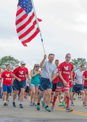 U.S. Air Force Col. Bradley McDonald, 88th Air Base Wing commander holds the U.S. flag during the Run for the Fallen on Area B flight line at Wright-Patterson Air Force Base, Ohio, September 9, 2016.  The Run for the Fallen provides an opportunity to remember and honor those who lost their lives and recognize those who continue to defend the nation. (U.S. Air Force photo by Michelle Gigante)