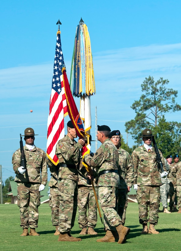 Maj. Gen. Mark T. McQueen, commander of the 108th Training Command (Initial Entry Training), passes the 98th Training Division (IET) colors to Brig. Gen. Miles Davis during an assumption of command ceremony on September 11, 2016 at the National Infantry Museum Parade Field at Fort Benning. The 98th Training Division (IET) is an Army Reserve division headquartered at Fort Benning, Georgia. Their primary mission is to provide drill sergeants to train Soldiers in basic training, advanced individual training and other various noncommissioned officer and officer professional development courses. Davis, an Infantry Branch officer, is a resident of Livonia, Michigan. McQueen resides in Lynn Haven, Florida.