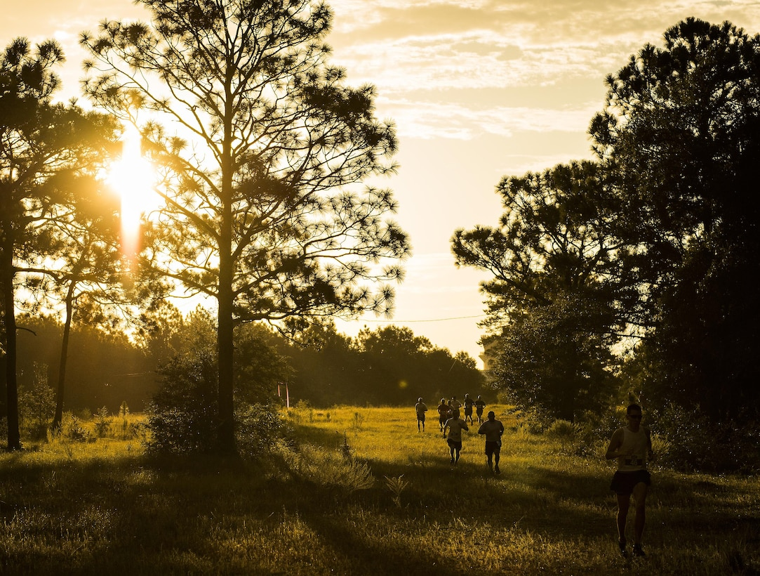 Airmen begin the 9/11 Memorial 6k trail run at sunrise Sept. 11 at Duke Field, Fla.  About 100 Airmen and families participated in the run.  Along the path, there were remembrance signs of fallen Air Force special operators who lost their lives after 9/11.  (U.S. Air Force photo/Tech. Sgt. Sam King)