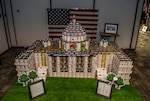 """DLA Land and Maritime Strategic Acquisitions Program Directorate's """"Soup-a-Stars"""" team used a combination of canned and boxed food items to recreate the U.S. Capitol Building during The Build competition Aug. 24. The contest was the culminating event of the annual Feds Feed Families campaign."""