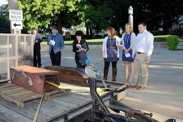 Defense Logistics Agency employees view a piece of the steel beams salvaged from the debris of the World Trade Center on display at the Patriot Day event.