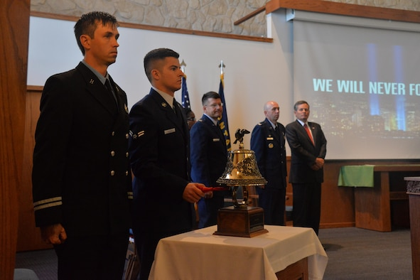 Airman 1st Class Matthew Adcock, 341st Civil Engineer Squadron firefighter, rings a bell during the 9/11 Remembrance ceremony Sept. 9, 2016, at Malmstrom Air Force Base, Mont. The ringing of the bell symbolizes the end of the duty day for the firemen who lost their lives on Sept. 11, 2001. (U.S. Air Force photo/Airman 1st Class Daniel Brosam)