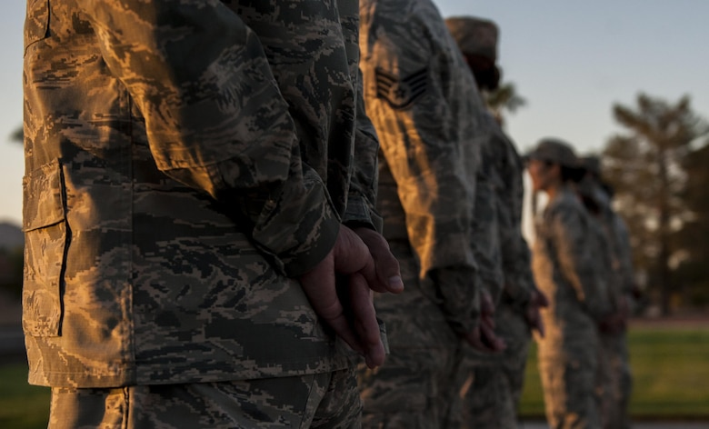 Airmen from Nellis Air Force Base stand at post to honor the lives lost on Sept. 11 in front of the United States Air Force Warfare Center, Sept. 9, 2016. Sept. 11th was a defining moment in American History, and part of honoring those that were lost is remembering just how the event affected this country and its people. (U.S. Air Force photo by Airman 1st Class Kevin Tanenbaum/Released)