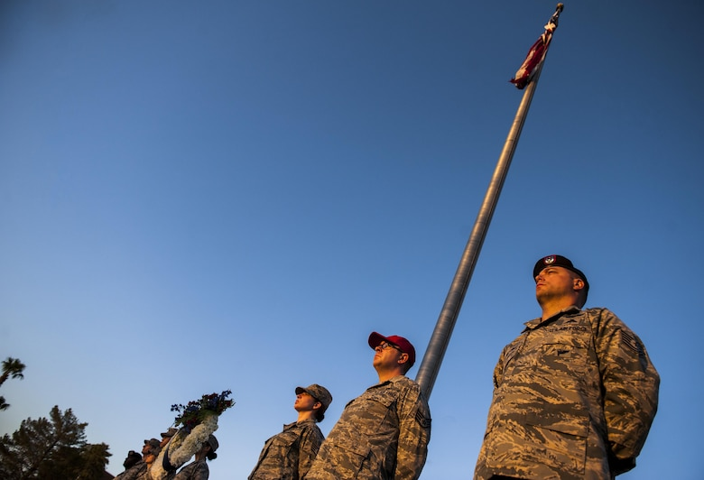 Airmen from Nellis Air Force Base stand at post to honor the lives lost on Sept. 11 in front of the base flagpole, Sept. 9, 2016. On 9/11, the United States experienced the largest attack on domestic soil since Pearl Harbor, causing the deaths of thousands of civilians and first responders. (U.S. Air Force photo by Airman 1st Class Kevin Tanenbaum/Released)
