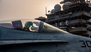 A Navy pilot assigned to Strike Fighter Squadron 131 taxies an F/A-18C Hornet on the flight deck of the aircraft carrier USS Dwight D. Eisenhower in the Persian Gulf, Sept. 9, 2016. The Eisenhower and its carrier strike group are deployed in support of Operation Inherent Resolve, maritime security operations and theater security cooperation efforts in the U.S. 5th Fleet area of operations. Navy photo by Petty Officer 3rd Class Nathan T. Beard