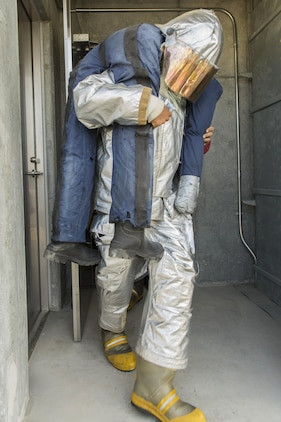 A U.S. Marine carries a simulated casualty during a 9/11 Memorial Stair Climb at Marine Corps Air Station Iwakuni, Japan, Sept. 9, 2016. Aircraft Rescue and Firefighting Marines with Headquarters and Headquarters Squadron hosted the event, which allowed station residents the opportunity to walk in the shoes of the firefighters who responded to the attacks. (U.S. Marine Corps photo by Lance Cpl. Aaron Henson)