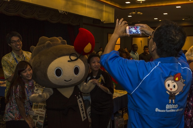 Japanese locals pose for a photo with Rato-chan, the official mascot of Ota City, during the Iwakuni Expo at Marine Corps Air Station Iwakuni, Japan, Sept. 10, 2016. The expo provided residents a glimpse of the services that are available to them on and off the air station such as tourist destinations, shopping malls and local hotels. (U.S. Marine Corps photo by Lance Cpl. Aaron Henson)