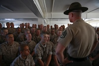 Recruits from Alpha Company, 1st Recruit Training Battalion, receive instructions from a drill instructor during pick up at Marine Corps Recruit Depot San Diego, Sept. 9, 2016. The recruits will spend their first day with their drill instructors learning the rules and regulations of recruit training, regarding everything from how to act in the squad bay to how to speak to drill instructors. Annually, more than 17,000 males recruited from the Western Recruiting Region are trained at MCRD San Diego. Alpha Company is scheduled to graduate Dec. 2.