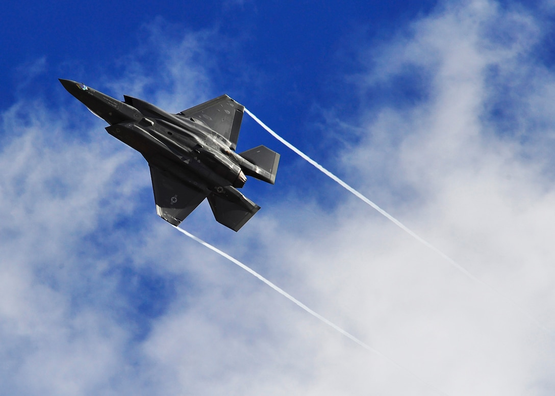 An F-35 Lightning II performs a maneuver Sept. 12, 2016 over Luke Air Force Base, Ariz. This sortie marks the 10,000th flying hour for the F-35 program at Luke. (U.S. Air Force photo by Senior Airman Devante Williams)