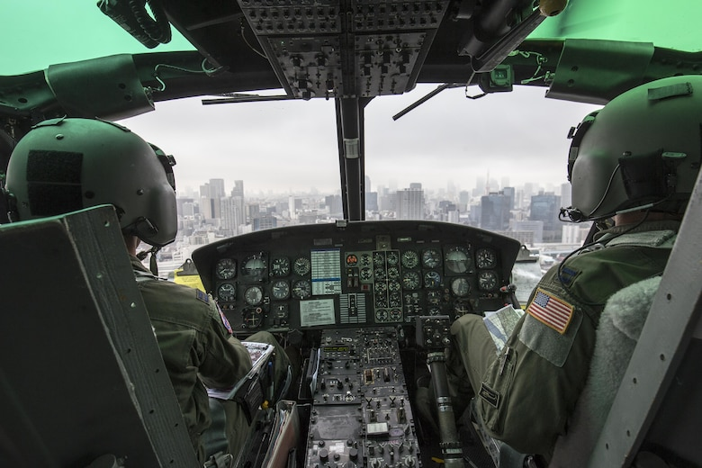 Capt. Jonathan Bonilla and Capt. Vicente Vasquez, 459th Airlift Squadron UH-1N Iroquois pilots, fly over Tokyo metropolis, Sept. 4, 2016. Airmen with the 459 AS delivered simulated disaster relief supplies to the Tokyo Rinkai Disaster Prevention Park during annual Tokyo Metropolitan Government Disaster Management Drill. The park is located in the Ariake area and is a disaster countermeasure headquarters of the Government of Japan and other local governments during large-scale earthquakes in the metropolitan area. (U.S. Air Force photo by Yasuo Osakabe/Released)