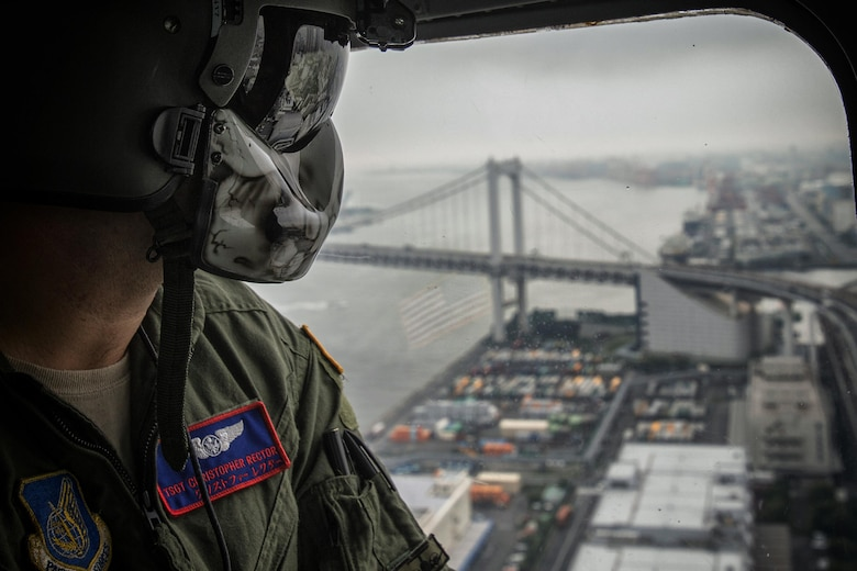 Tech. Sgt. Christopher Rector, 459th Airlift Squadron flight engineer, performs visual confirmation over Tokyo Bay, Sept. 4, 2016, during the Annual Tokyo Metropolitan Government Disaster Management Drill. Airmen with the 459 AS delivered simulated disaster relief supplies to the Tokyo Rinkai Disaster Prevention Park during annual Tokyo Metropolitan Government Disaster Management Drill. The park is located in the Ariake area and is a disaster countermeasure headquarters of the Government of Japan and other local governments during large-scale earthquakes in the metropolitan area. (U.S. Air Force photo by Yasuo Osakabe/Released)