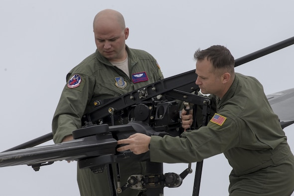 (Right to left) Senior Master Sgt. Edward Sponenburg, 459th Airlift Squadron superintendent, and Tech. Sgt. Christopher Rector, 459 AS flight engineer, perform pre-flight inspection on a UH-1N Iroquois at Yokota Air Base, Japan, Sept. 4, 2016, during the Tokyo Metropolitan Government Disaster Management Drill. Airmen with the 459 AS delivered simulated disaster relief supplies to the Tokyo Rinkai Disaster Prevention Park during the drill. The park is located in the Ariake area and is a disaster countermeasure headquarters of the Government of Japan and other local governments during large-scale earthquakes in the metropolitan area. (U.S. Air Force photo by Yasuo Osakabe/Released)