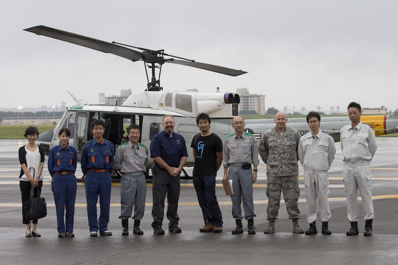 Members with the Tokyo Metropolitan Government, Fussa Red Cross, Musashimurayama City hall, and Airmen with the 374th Airlift Wing pose for a photo at Yokota Air Base, Japan, Sept. 4, 2016, during the Annual Tokyo Metropolitan Government Disaster Management Drill. Airmen with the 459 AS delivered simulated disaster relief supplies to the Tokyo Rinkai Disaster Prevention Park during annual Tokyo Metropolitan Government Disaster Management Drill. The park is located in the Ariake area and is a disaster countermeasure headquarters of the Government of Japan and other local governments during large-scale earthquakes in the metropolitan area. U.S. Air Force photo by Yasuo Osakabe/Released)