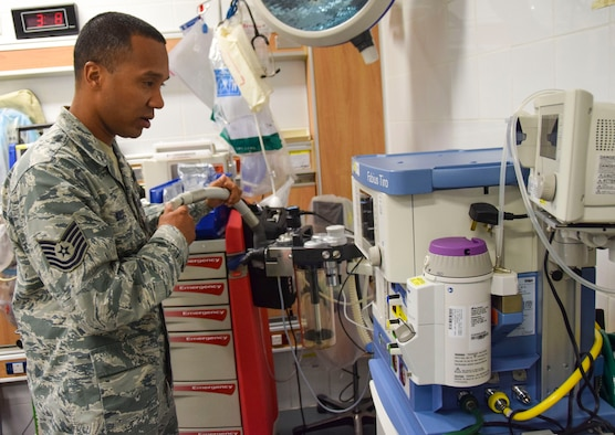 Tech. Sgt. Kristoffer Bruce, 379th Expeditionary Expeditionary Medical Operations Squadron biomedical equipment repair technician, does a maintenance check on a anesthesia machine at the emergency room Sept. 8, 2016, Al Udeid Air Base, Qatar. Bruces is also the facilities manager for the medical group and is in charge of 11 buildings here. (U.S. Air Force photo/Tech. Sgt. CarlosJ. Treviño/Released)