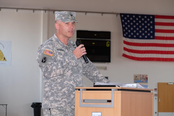 Col. John E. Dethlefs speaks after taking command of the 7th Mission Support Command's 209th Digital Liaison Detachment during a change of command ceremony at McCully Barracks Fitness Center, Sept. 10, 2016.