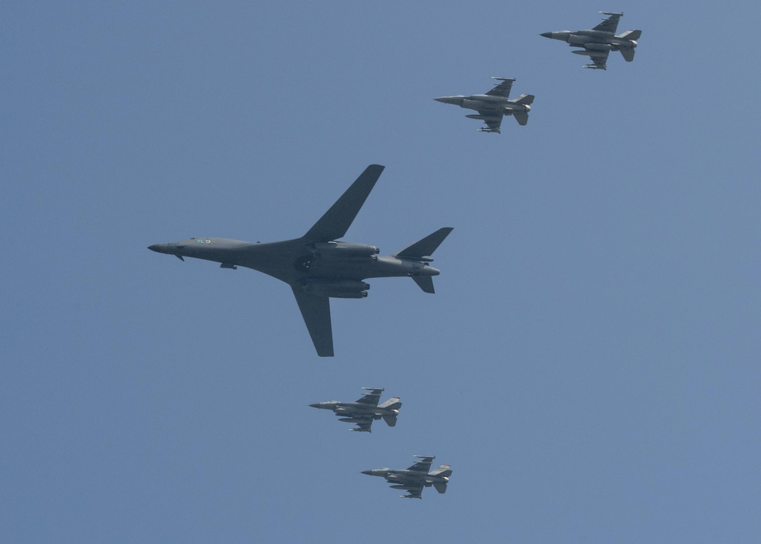 U.S. Air Force F-16 Fighting Falcons assigned to the 36th Fighter Squadron escort a U.S. Air Force B-1B Lancer from Andersen Air Force Base, Guam, during a flyover over Osan Air Base, Republic of Korea, Sept. 13, 2016. The B-1 is capable of rapidly delivering massive quantities of precision and non-precision weapons against any adversary, anywhere in the world, at any time. (U.S. Air Force photo by Victor J. Caputo)