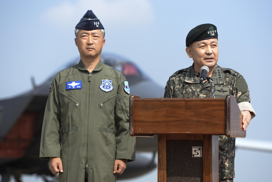 Republic of Korea air force Lt. Gen. Lee Wang Keun, Republic of Korea Air Forces Operations Center commander, stands by listening to Republic of Korea army Gen. Lee, Sun Jin, Chairman of the Republic of Korea Joint Chiefs of Staff, speak during a press conference following a flyover in response to recent provocative action by North Korea, Sept. 13. 2016, at Osan air Base, ROK. Two U.S. Air Force B-1 Lancers from Andersen Air Force Base, Guam, were joined by Republic of Korean F-15K Slam Eagles and U.S. Air Force F-16 Fighting Falcons during the flyover. The close military cooperation between the U.S. and ROK keeps us ready to respond at any time to those who would threaten stability and security. (U.S. Air Force photo by Tech. Sgt. Rasheen Douglas)