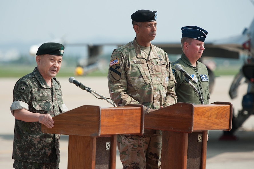 Republic of Korea army Gen. Lee, Sun Jin, Chairman of the Republic of Korea Joint Chiefs of Staff, joined by U.S. Army Gen. Vincent K. Brooks, U.S. Forces Korea commander, and U.S. Air Force Lt. Gen. Thomas Bergeson, 7th Air Forces commander, speaks during a press conference following a flyover in response to recent provocative action by North Korea, Sept. 13, 2016, at Osan Air Base, ROK. Two U.S. Air Force B-1B Lancers from Andersen Air Force Base, Guam, were joined by Republic of Korean F-15K Slam Eagles and U.S. Air Force F-16 Fighting Falcons during the flyover. The close military cooperation between the U.S. and ROK keeps us ready to respond at any time to those who would threaten stability and security. (U.S. Air Force photo by Staff Sgt. Jonathan Steffen)