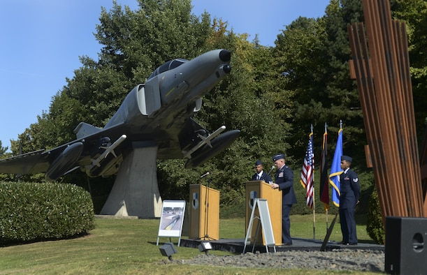 Col. Joe McFall, 52nd Fighter Wing commander, recites a first-person narrative of the events of Sept. 11, 2001 during a memorial service at Spangdahlem Air Base, Germany, Sept. 9, 2016. Airmen throughout the Air Force held memorial ceremonies honor the victims, lost service members and emergency response teams as part of the 15th anniversary of the attacks. (U.S. Air Force photo/Senior Airman Dawn M. Weber)