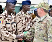 U.S. Air Force Lt. Col Brady Vaira, right, 435th Contingency Response Group deputy commander, meets with airman from Chad following African Partnership Flight opening ceremony Sept. 12, 2016. Twelve African counties are participating in AFP Ghana with the common goal of increasing regional capabilities while building relationships throughout West Africa. (U.S. Air Force photo by Staff Sgt. Stephanie Longoria)