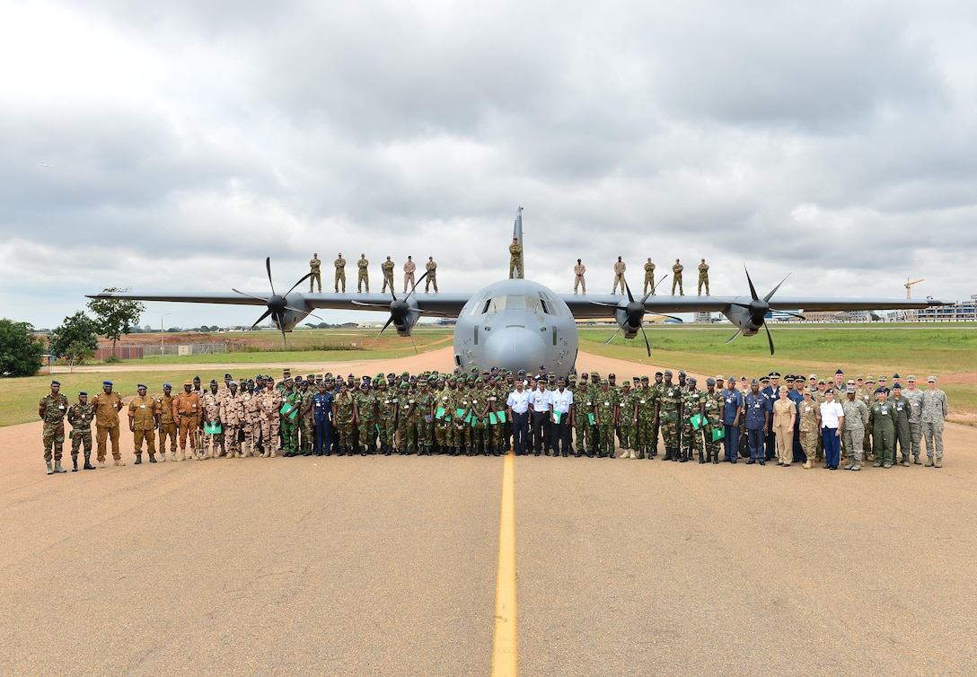 African Partnership Flight participants pose in front of an C-130J Super Hercules for a group photo Sept. 12, 2016. Twelve West African counties are participating in APF Ghana, the focus of this APF is expeditionary air base buildup. (U.S. Air Force photo by Staff Sgt. Stephanie Longoria)