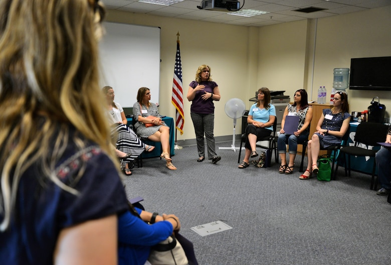 Genevieve Brock, 100th Air Refueling Wing Sexual Assault Prevention and Response victim advocate, briefs Team Mildenhall spouses Sept. 8, 2016, on RAF Mildenhall, England. The Spouse Immersion Tour gave Team Mildenhall spouses an opportunity to network and gain a better understanding of programs and facilities on base. (U.S. Air Force photo by Senior Airman Christine Halan)