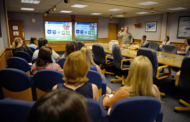 U.S. Air Force Col. Thomas D. Torkelson, 100th Air Refueling Wing commander, briefs the wing's mission to Team Mildenhall spouses Sept. 8, 2016, on RAF Mildenhall, England. The Spouse Immersion Tour gave Team Mildenhall spouses an opportunity to network and gain a better understanding of programs and facilities on base. (U.S. Air Force photo by Senior Airman Christine Halan)