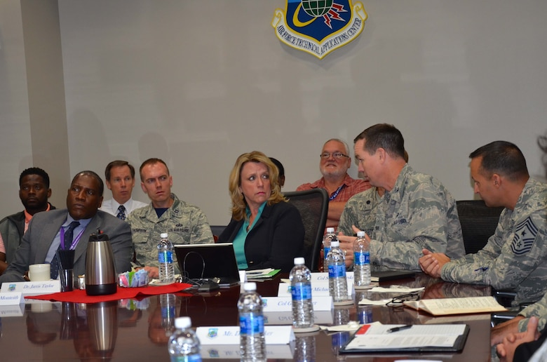 160909-SR919-001 -- Secretary of the Air Force Deborah Lee James listens to Col. Steven M. Gorski, commander of the Air Force Technical Applications Center, discuss the actions AFTAC has taken with regard to North Korea's purported nuclear test Sept. 9, 2016.  James was visiting Patrick AFB, Fla., to witness the launch of an Atlas V rocket and took time out of her schedule to get briefed by Gorski and his nuclear treaty monitoring experts about how the center measures seismic activity and compliance with nuclear treaties. The secretary was also briefed about the capabilities of the WC-135 Constant Phoenix, AFTAC's atmospheric collection aircraft that has been deployed to the region to collect accurate information on levels of potential radiation in the area of concern.  Pictured at the table from left to right:  Dr. Jarris Taylor, James' deputy assistant on Strategic Diversity Integration, James, Gorski, and Chief Master Sgt. Michael Joseph, AFTAC's Command Chief.