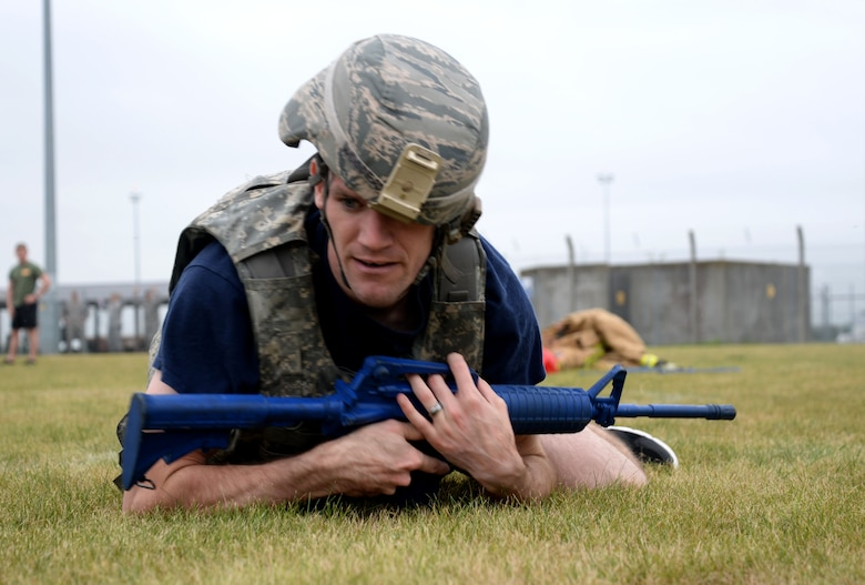 U.S. Air Force Staff Sgt. David Jeghers, 100th Civil Engineer Squadron Fire Department crew chief, performs low crawls after donning battle rattle Sept. 7, 2016, on RAF Mildenhall, England. Firefighters and defenders from the 48th CES and 48th Security Forces Squadron from RAF Lakenheath, compete in teamwork challenges with their counterparts from RAF Mildenhall's 100th CES and 100th SFS. The Battle of the Badges competition highlights the camaraderie between the career fields and pays homage to the first responders who lost their lives on 9/11. (U.S. Air Force photo by Senior Airman Justine Rho)