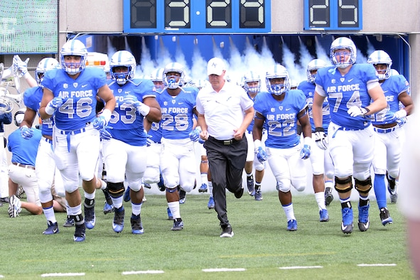 Falcons' head coach Troy Calhoun leads Air Force on to the field at Falcon Stadium, Sept. 3, to take on the Abilene Christian University Wildcats. Air Force beat Abilene 37-21. (U.S. Air Force photo/Darcie Ibidapo)