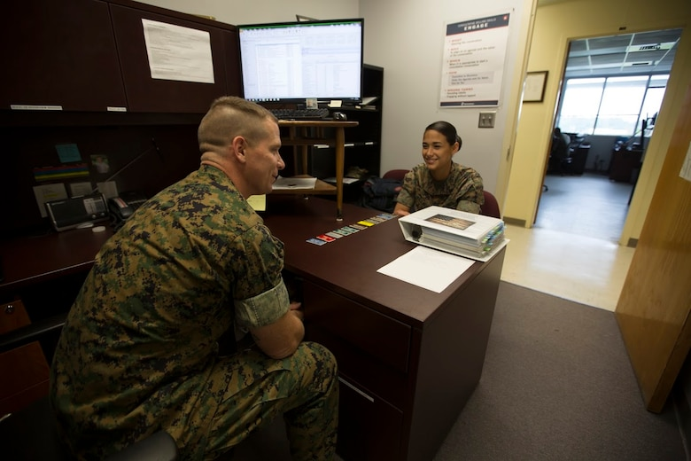 Staff Sgt Craig W. Harriman, left, speaks to Cpl. Andrea N. Villacis about her career progression aboard Marine Corps Air Station Cherry Point, N.C., Sept. 12, 2016. Harriman was awarded Career Planner of the Year for fiscal year 2016 and has been recently selected to instruct at the Basic Career Planners Course at Marine Corps Recruit Depot, San Diego, Calif. He attributes his success to the leadership and mentoring he received during his years in the Corps. Harriman is the staff noncommissioned officer in charge of career planners assigned to Marine Air Control Group 28, 2nd Marine Aircraft Wing. Villacis is an administrative clerk with the unit. (U.S. Marine Corps photo by Sgt. N.W. Huertas/ Released)