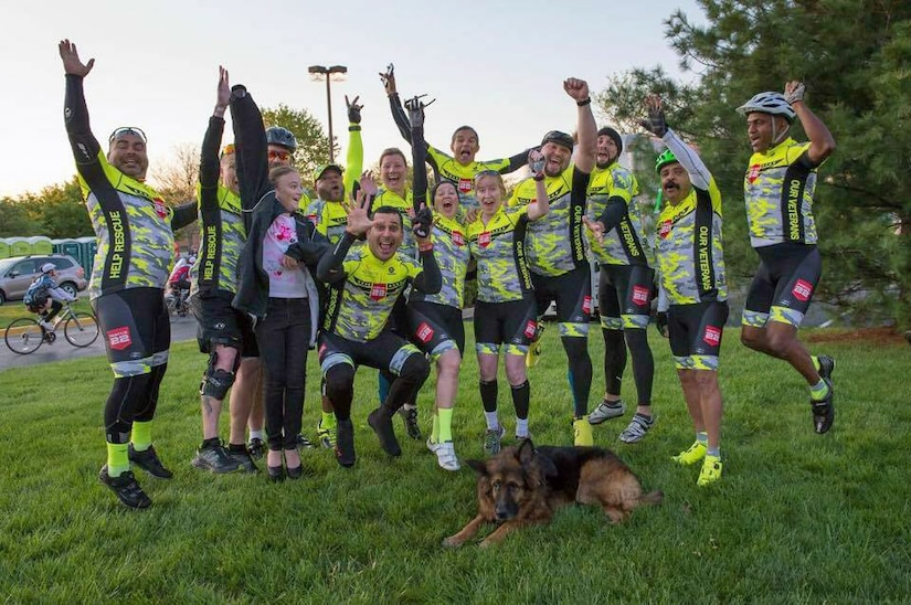 The Rescue 22 team takes a moment to celebrate completing the first day of the two day, 110-mile ride from Arlington, Va., to Gettysburg, Pa., as part of the annual Face of America bike ride, April 25-26, 2015. Throughout the weekend, the veterans performed pushups and wore photos of fallen service members to raise awareness about suicide prevention. Courtesy photo