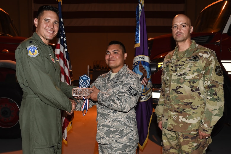 U.S. Air Force Tech. Sgt. Eric Anthony C. Bamba (center), Army Support Activity housing NCO in charge, poses for a photo with Lt. Col. David Aragon, 612th Air Base Squadron commander, and U.S. Army Cmd. Sgt. Maj. Robin Bolmer, ASA command sergeant major, during the first senior non-commissioned officer induction ceremony held at Soto Cano Air Base, Honduras, Sept. 9, 2016. Bamba was raised in Guam, and entered the Air Force in 2000.