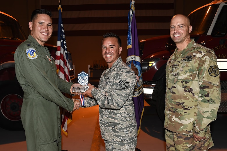 U.S. Air Force Tech. Sgt. Donovan A. Chavez (center), 612th Air Base Squadron radar systems NCO in charge, poses for a photo with Lt. Col. David Aragon, 612th ABS commander, and U.S. Army Cmd. Sgt. Maj. Robin Bolmer, Army Support Activity command sergeant major, during the first senior non-commissioned officer induction ceremony held at Soto Cano Air Base, Honduras, Sept. 9, 2016. Chavez was raised in Barstow, Calif., and entered the Air Force in 2004.