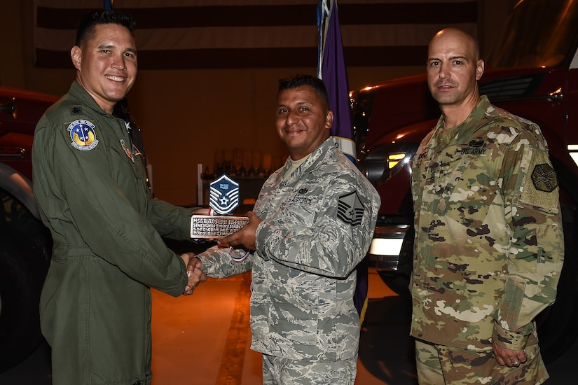 U.S. Air Force Master Sgt. Joseph A. Flores (center), 612th Air Base Squadron assistant fire chief of fire operations, poses for a photo with Lt. Col. David Aragon, 612th ABS commander, and U.S. Army Cmd. Sgt. Maj. Robin Bolmer, Army Support Activity command sergeant major, during the first senior non-commissioned officer induction ceremony held at Soto Cano Air Base, Honduras, Sept. 9, 2016. Flores was raised in San Antonio, Texas, and entered the Air Force in 1998.