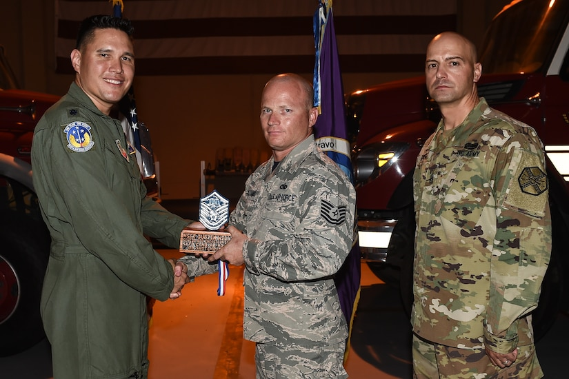 U.S. Air Force Tech. Sgt. Justin M. Williams (center), 612th Air Base Squadron aerospace ground equipment section chief, poses for a photo with Lt. Col. David Aragon, 612th ABS commander, and U.S. Army Cmd. Sgt. Maj. Robin Bolmer, Army Support Activity command sergeant major, during the first senior non-commissioned officer induction ceremony held at Soto Cano Air Base, Honduras, Sept. 9, 2016. Williams was raised in Navarre, Fla., and joined the Air Force in 2002.