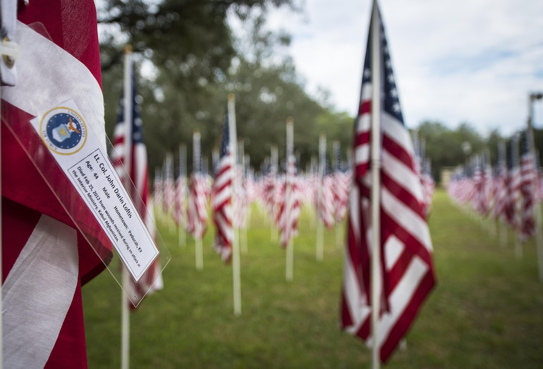 Lt. Col. John Loftis' name was attached to one of the flags set up on the Field of Valor display in Niceville, Fla. Sept. 12. The display features 13 rows of 27 flags and one extra to create the field. Names of recently fallen military members, including 10 Airmen, adorn each of the approximately 352 American flags. The Field will be on display through Sept. 17 at the Mullet Festival grounds and is free to the public. (U.S. Air Force photo/Samuel King Jr.)