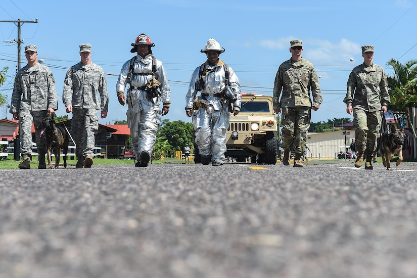 Members of Joint Task Force-Bravo's Joint Security Forces, Medical Element and Fire Emergency Services march together during a silent parade held in honor of the emergency services personnel who lost their lives during the terrorist attacks of Sept. 11, 2001, before the start of the 9/11 remembrance ceremony at Soto Cano Air Base, Honduras, Sept. 9, 2016. More than 200 service members met in the JSF compound and marched in the silent parade to the 612th Air Base Squadron's fire department.