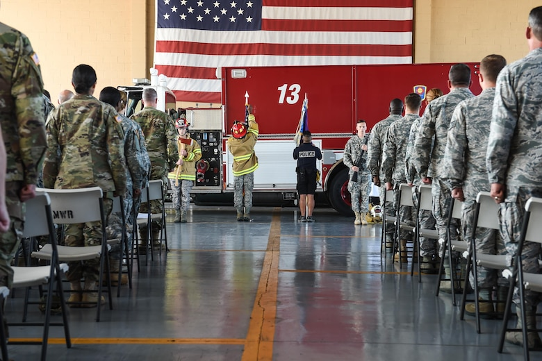 Attendees of the 9/11 remembrance ceremony stand at attention while a special color guard comprised of members of Joint Task Force-Bravo's Joint Security Forces, Medical Element and Fire Emergency Services post the colors at Soto Cano Air Base, Honduras, Sept. 9, 2016. More than 200 members of JTF-Bravo attended the ceremony held to honor the 447 emergency services personnel who lost their lives during the terrorist attacks of Sept. 11, 2001.