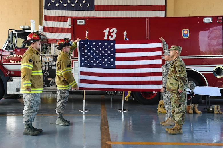 Members of Joint Task Force-Bravo's Fire Emergency Services and Joint Security Forces prepare to fold an American flag in honor of the emergency services personnel who lost their lives during the terrorist attacks of Sept. 11, 2001, during the 9/11 remembrance ceremony at Soto Cano Air Base, Honduras, Sept. 9, 2016. After the flag was folded, it was laid to rest on the ceremony's emergency services monument, and rendered a salute to honor the fallen heroes.