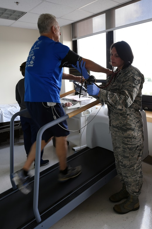 Staff Sgt. Sabra Hay, a cardiopulmonary respiratory technician with the 59th Medical Specialty Squadron, puts a patient through a cardiac stress test at the Wilford Hall Ambulatory Surgical Center, Joint Base San Antonio-Lackland. The test checks the electrical conductivity of the heart during exercise. It can help diagnose blocked arteries. Cardiology services at Wilford Hall include a full range of non-invasive cardiac testing and diagnostics. (U.S. Air Force photo/Staff Sgt. Jason Huddleston)